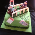 a green square cake featuring two horses and jockey's with sugar printed money and betting slips